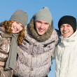Smiling young group in winter — Stock Photo #5427985