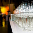 Heap of stemware glass at party — Stock Photo