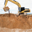 Loader ecavator at sand quarry — Stock Photo