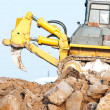 Bulldozer loader at winter frozen soil excavation works — Foto de Stock