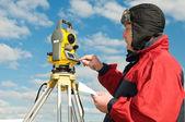 Surveyor works with theodolite — Stock Photo