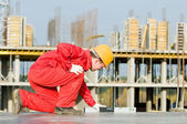 Builder with digital level — Stock Photo