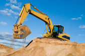 Track-type loader excavator at sand quarry — Stock Photo
