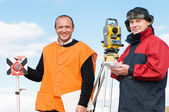 Surveyor workers with theodolite equipment — Stock Photo