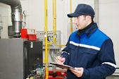 Heating engineer in boiler room — Stock Photo