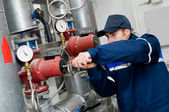 Heating engineer in boiler room — Stock fotografie