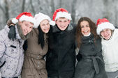 Group of smiling young in winter — Stock Photo
