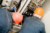 Electricians at wire installing work — Stock Photo