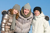 Smiling young group in winter — Stock Photo