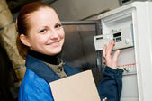 Cheerful woman engineer in a boiler room — Stock Photo