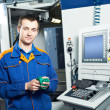 Worker at tool workshop - Stock Photo