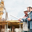 Engineers builders at construction site — Stock Photo