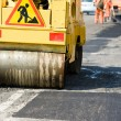 Asphalt paving works with compactor — Stock Photo #5456971