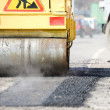 Asphalt paving works with compactor — Stock Photo #5456979