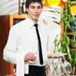 camarero en uniforme en restaurante — Foto de Stock