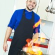 Chef making flambe meat — Stock Photo #5457059