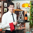 Waiter in uniform at restaurant — Stock Photo #5457063