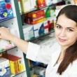 Pharmacy chemist woman in drugstore - Stockfoto
