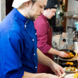 Chefs at decoration food — Foto Stock