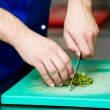 Cutting greens on board — Stock Photo