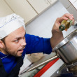 Chef cooking a soup — Stock Photo