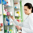 pharmacy chemist woman in drugstore — Stock Photo