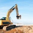Excavator loader at winter works — Stock Photo