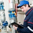 Heating engineer in boiler room — Stock Photo #5457555