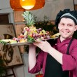 Cheerful chef cook with fruits — Stock fotografie