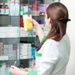 Stock Photo: Pharmacy chemist woman in drugstore