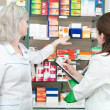 Pharmacy chemist women in drugstore — Stock Photo #5457798