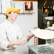 Pizza baker juggling with dough — Stock Photo #5457970