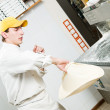 Pizza baker juggling with dough — Stock Photo #5457973