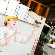 Stock Photo: Pizza baker juggling with dough