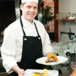 Photo: Chef with prepared food on plates