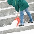 Man shoveling winter snow — Stock Photo
