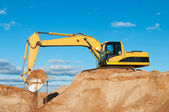 Track-type loader excavator at sand quarry — Stock Photo