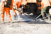 Asphalt paving works — Stock Photo