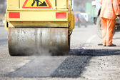 Asphalt paving works with compactor — Stock Photo