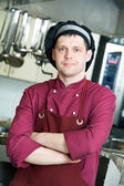 Chef in uniform at kitchen — Stock Photo
