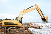 Excavator loader at winter works — Stock Photo