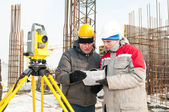 Surveying works at construction site — Stock Photo