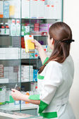 Pharmacy chemist woman in drugstore — Stok fotoğraf
