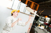 Pizza baker juggling with dough — Stock Photo