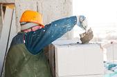 Worker mason at bricklaying work — Stock Photo