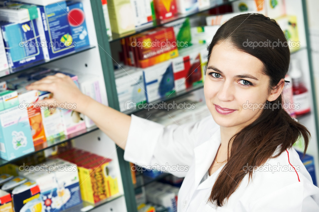 Happy cheerful pharmacist chemist woman standing in pharmacy drugstore — Stock Photo #5457128
