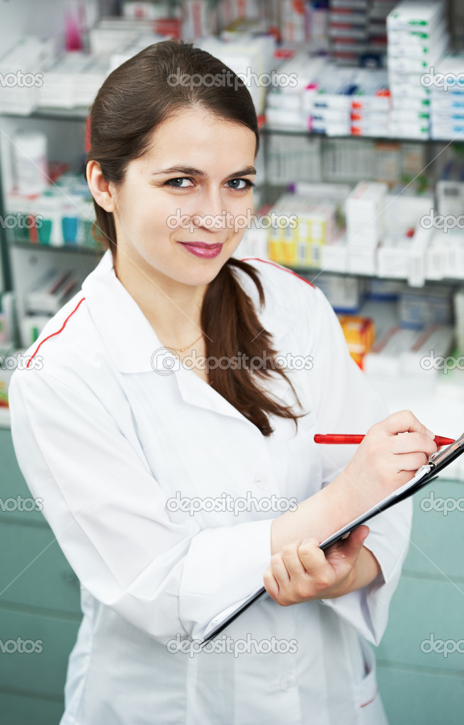 Positive pharmacist chemist woman standing in pharmacy drugstore with clipboard — Stock Photo #5457133