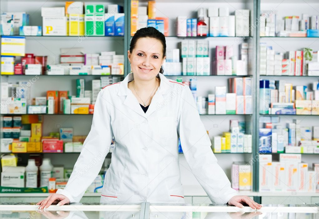 Happy cheerful pharmacist chemist woman standing in pharmacy drugstore — Stock Photo #5457380