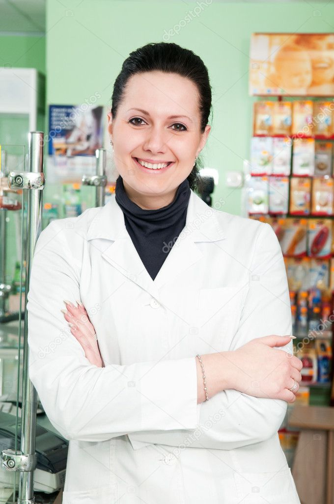 Happy cheerful pharmacist chemist woman standing in pharmacy drugstore  Stock Photo #5457752