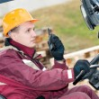 Forklift driver with radio transmitter - Stock Photo